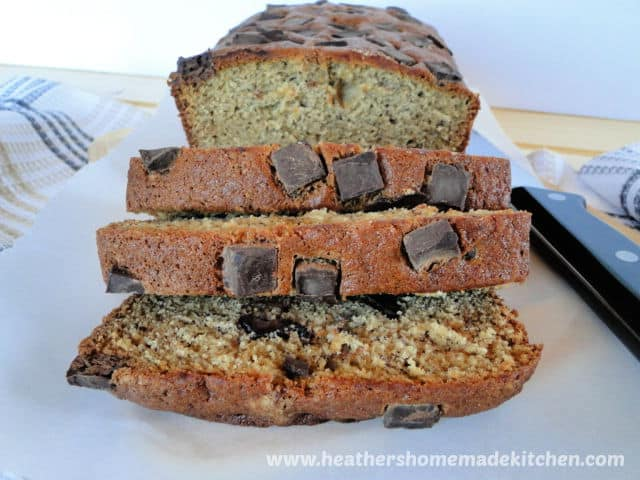 Banana Bread Dark Chocolate Chip Muffins in loaf form with slices in front.
