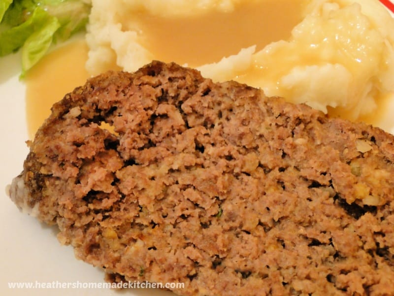 Slice of inside of Grandma's Famous Meatloaf with mashed potatoes