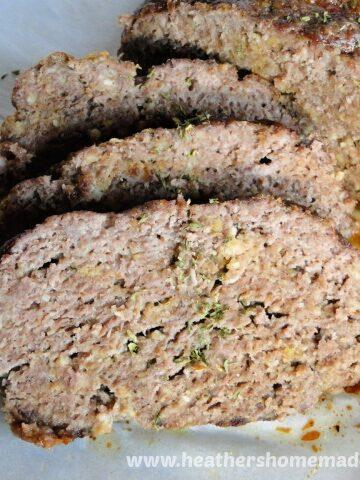 Grandma's Famous Meatloaf Slices next to loaf.