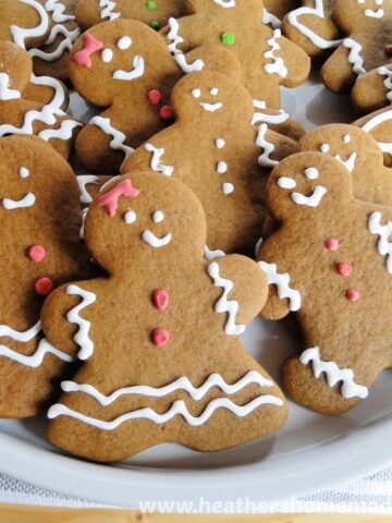 Gingerbread Men Cookies on white round platter.