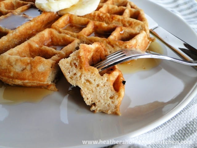 Close up view of Banana Belgian Waffles bite on fork.