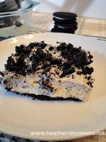 Side view of slice of No Bake Cookies N' Cream Cheesecake Bars.