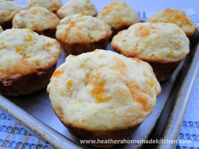 Close up view of Cheesy Corn Muffins on sheet pan.