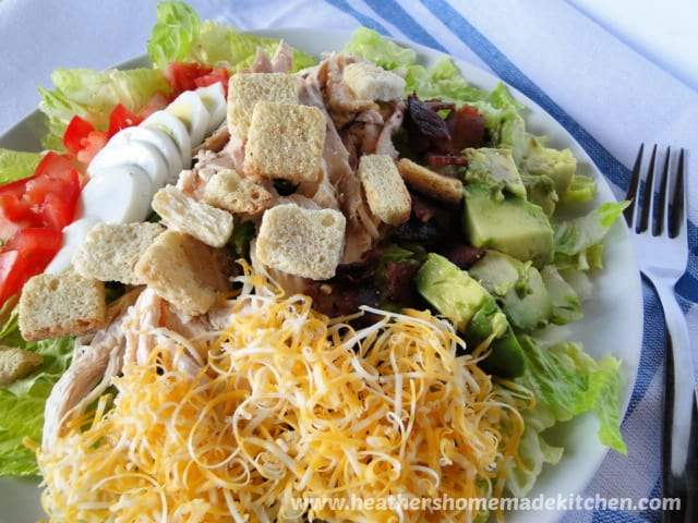 Close up view of Roast Chicken Cobb Salad with croutons.