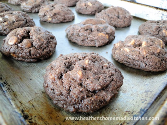 Rows of Peanut Butter Chip Chocolate Cookies on sheet pan.