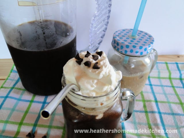 Instant Pot Iced Coffee in mason jar mug with whipped cream, chocolate chips and pitcher.
