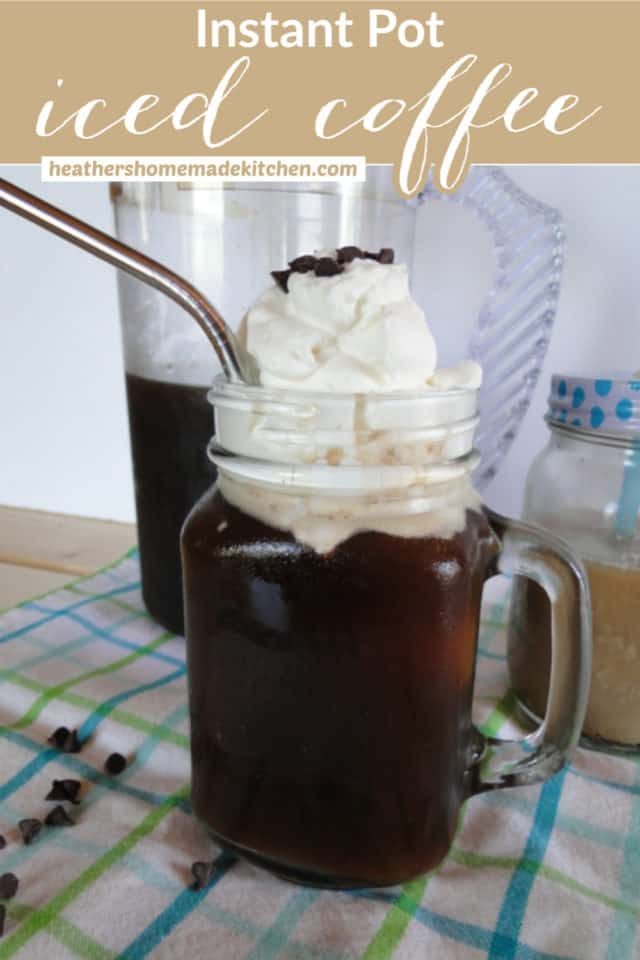 Instant Pot Iced Coffee in mason jar mug with whipped cream and steel straw.