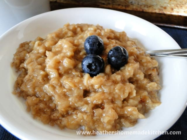 Instant Pot Maple Brown Sugar Oatmeal close up view with spoon and garnished with blueberries.