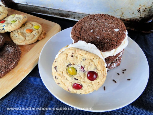 Ice Cream Cookie Sandwiches on plate with cookies on board next to plate.
