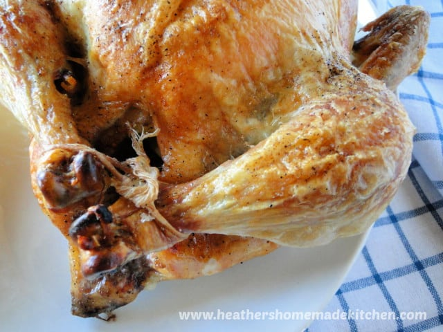 Perfect Roast Chicken with crispy skin and legs trussed with kitchen twine and