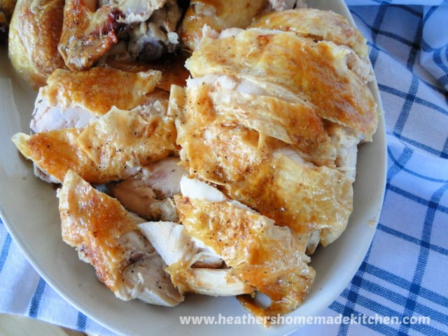 Perfect Roast Chicken sliced chicken breasts on white platter.