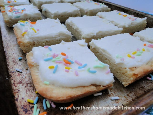 Front view of Sugar Cookie Bars in rows on sheet pan.