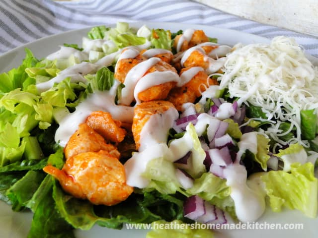 Buffalo Chicken Salad with drizzle of ranch dressing on top.