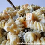 Dill Pickle Pasta Salad in glass bowl with spoon