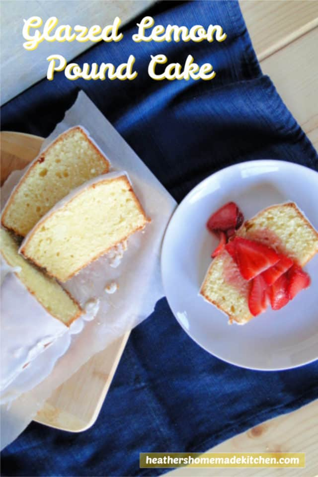 Top view Glazed Lemon Pound Cake with slice topped with sliced strawberries.