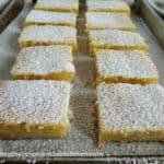 Sliced Lemon Bars on sheet pan.