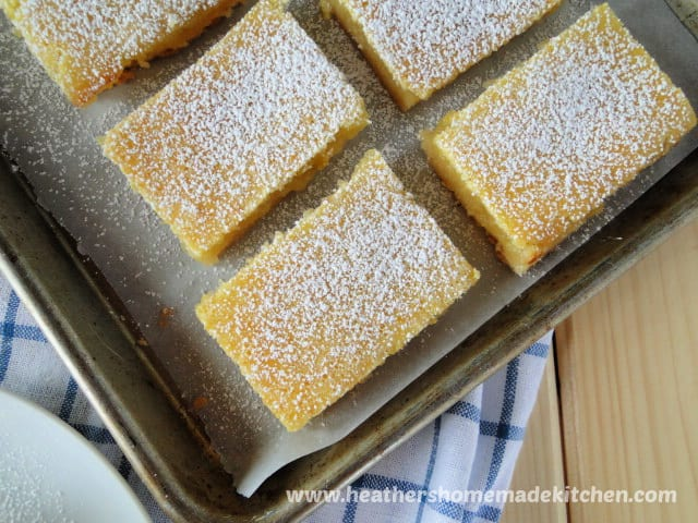 Lemon Bars in 2 rows on sheet pan.