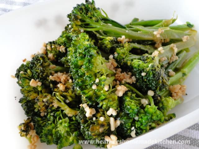 Garlicky Broccolini Front view in white dish.