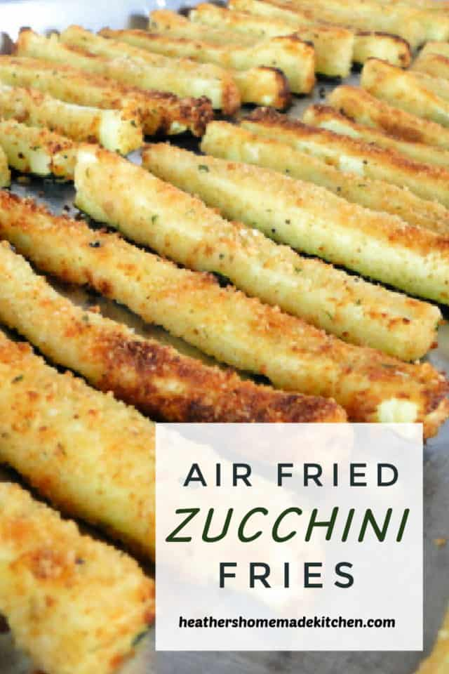 Air Fryer Zucchini Fries in rows on sheet pan.