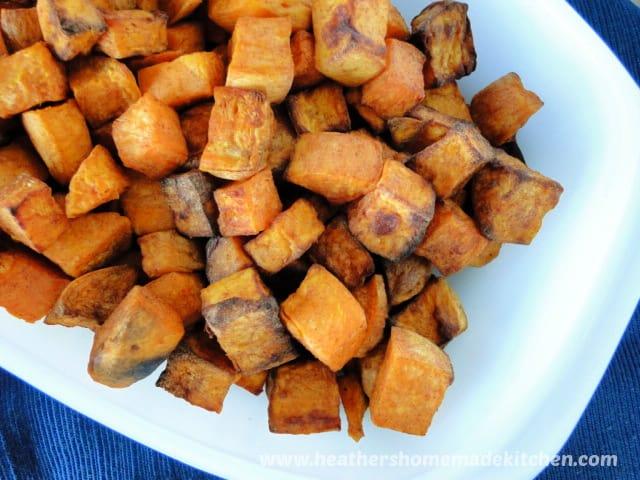 Top view of Air Fryer cubed Cinnamon Sweet Potatoes in white bowl.