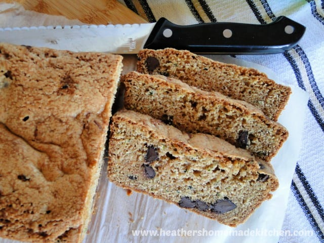 Chocolate Chip Zucchini Bread with 3 slices view of inside of slices and chocolate chips showing.