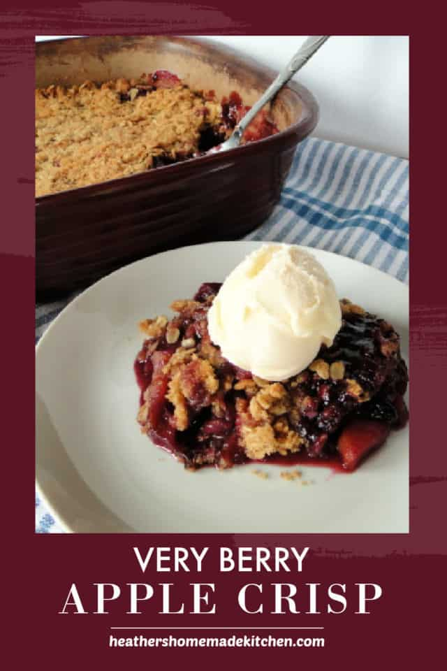 Very Berry Apple Crisp in baking dish with serving on plate with scoop of vanilla ice cream.