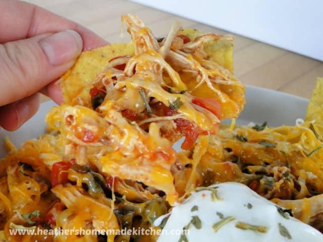 Instant Pot Salsa Chicken Nachos close up view of chicken on chip.
