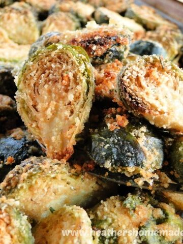Roasted Garlic Parmesan Brussels Sprouts on spatula and sheet pan.