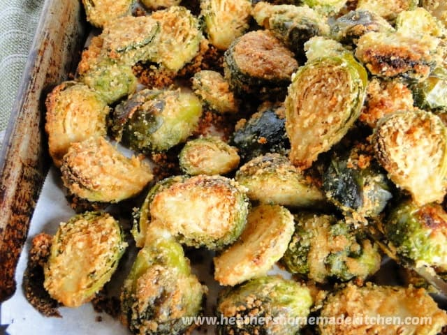 Roasted Parmesan Garlic Brussels Sprouts on sheet pan and spatula