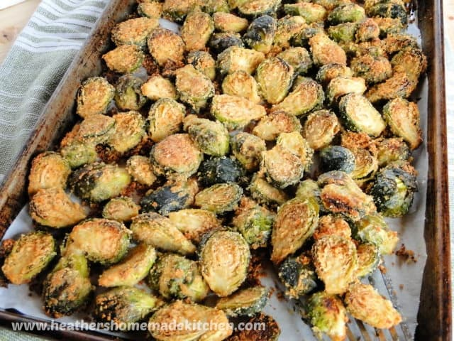 Top view of Roasted Parmesan Garlic Brussel Sprouts on sheet pan.
