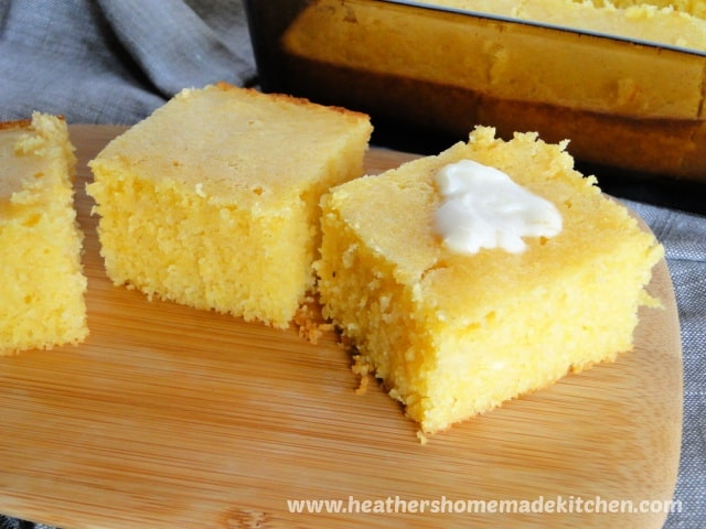 Side view of Sweet Cornbread slices with butter on top.