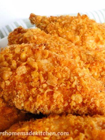 Close view of crispy coated corn flake chicken tenders