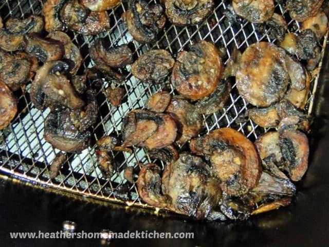 Air Fryer Garlic Mushrooms in air fryer basket.