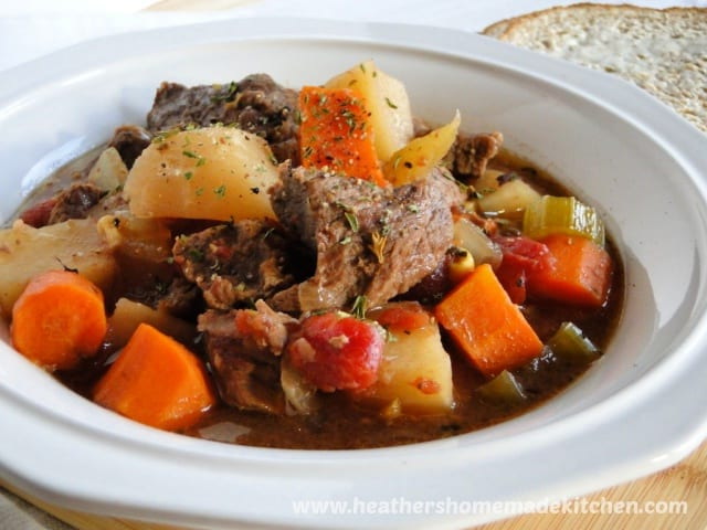 Side view of Crock Pot Beef Stew in white bowl.