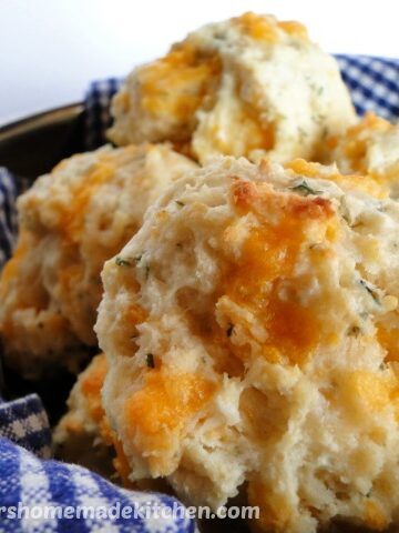 Garlic Cheese Drop Biscuits piled high in bowl.