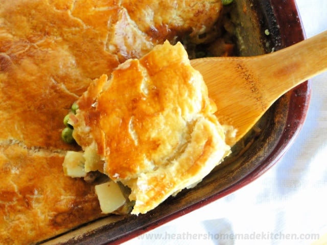 Top view of Turkey Pot Pie with Puff Pastry on wooden spoon.