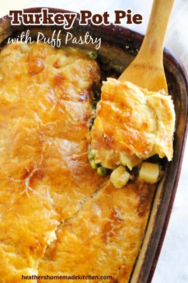 Top view of Turkey Pot Pie with Puff Pastry with corner scooped on wooden spoon.