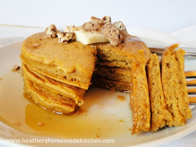 Stack of 3 Whole Wheat Pumpkin Pancakes with bite cut out and on fork.