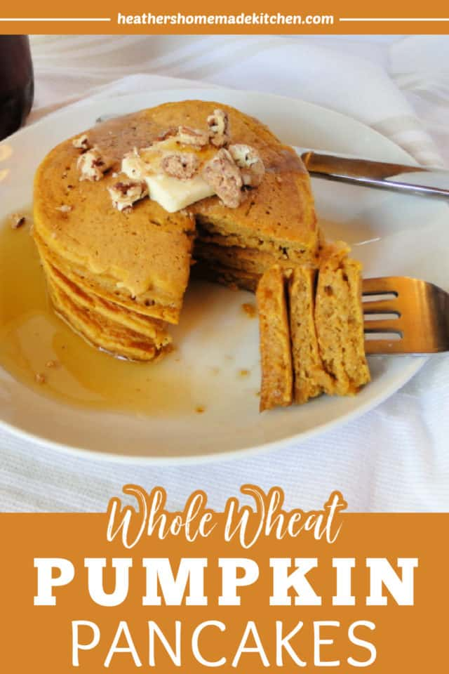 Stack of 3 Whole Wheat Pumpkin Pancakes on white plate with bite cut out on fork.