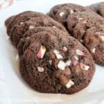 Chocolate Peppermint Drop Cookies layered in a row on white square platter.