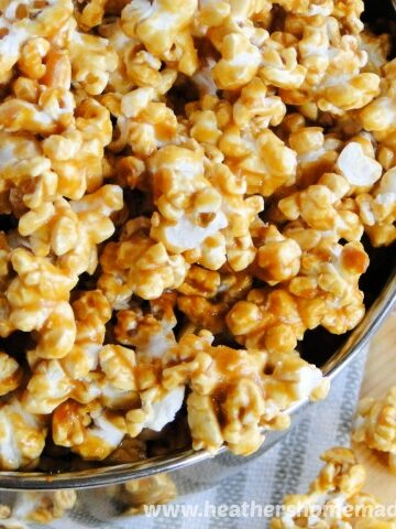 Easy Homemade Caramel Corn Recipe in bowl with scattered caramel corn.