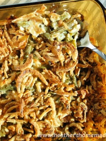 Homemade Green Bean Casserole in baking dish with spoon.