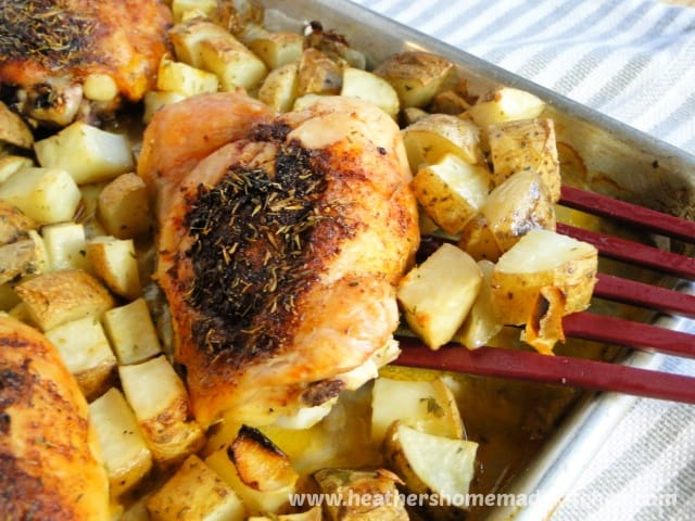 Close view of Pan Roasted Chicken & Potatoes chicken on spatula.
