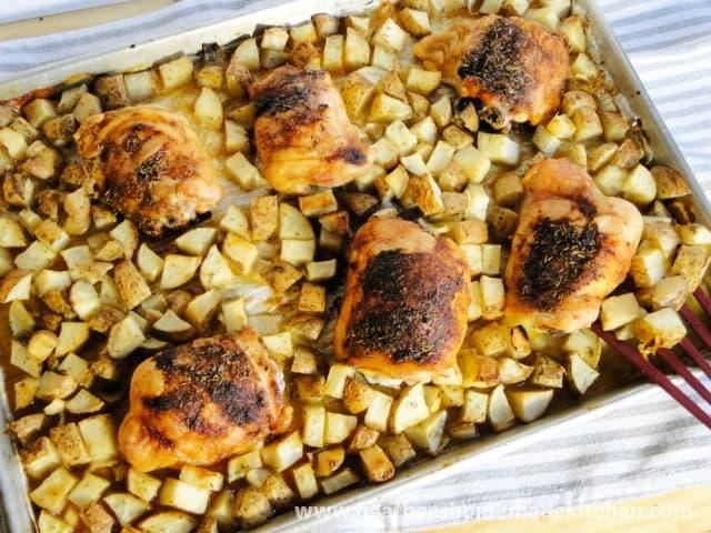 Top view of Pan Roasted Chicken & Potatoes on sheet pan.