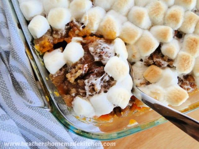 Spoonful of Sweet Potato Casserole in baking dish.