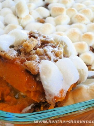 Sweet Potato Casserole with Marshmallows and corner scooped on spoon.