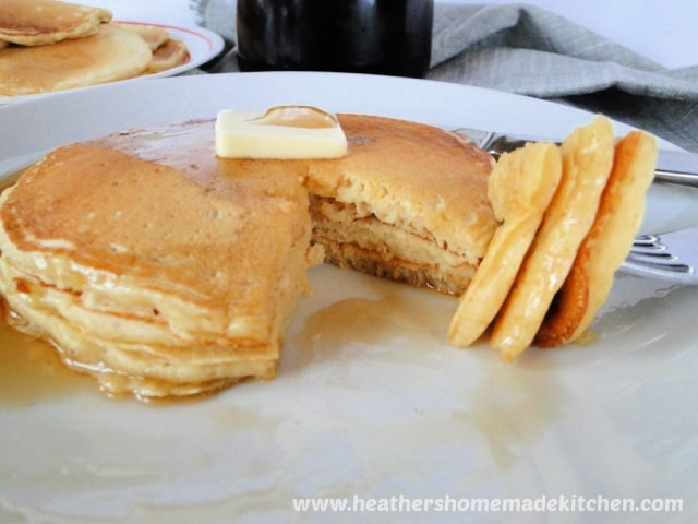 Close up view of inside Homemade Buttermilk Pancakes and bite of fork.