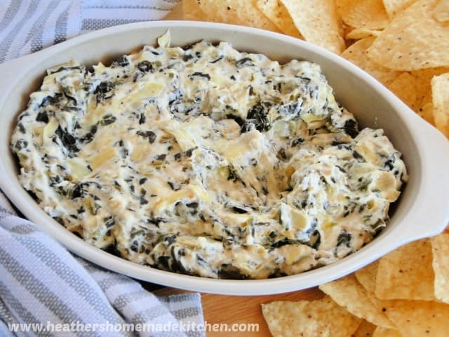 Top View of Crock Pot Spinach Artichoke Dip surrounded by tortilla chips.