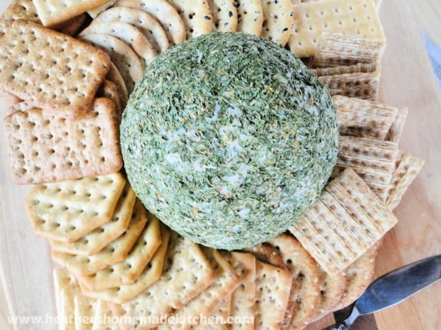 Top view of Holiday Cheese Ball in middle of crackers.