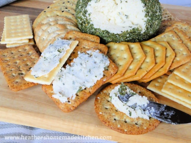 Holiday Cheese Ball spread on some crackers.